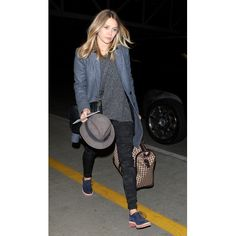 Elizabeth Olsen headed to the gate at LAX to catch a flight to NYC.