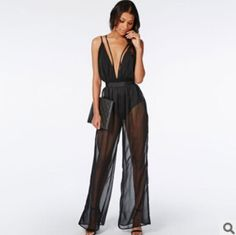 http://www.aliexpress.com/item/2015-New-Lace-Deep-V-Neck-Spaghetti-Strap-Hollow-Out-Fashion-Loose-Solid-sexy-rompers-womens/32436121926.html