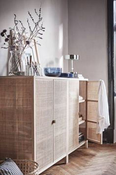 We've had our eye on this lacquered-rattan Stockholm cabinet for some time. Good news: It's about to land in-store.