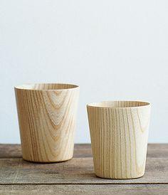 Castor Aralia wood and have a food-safe polyurethane coating inside.