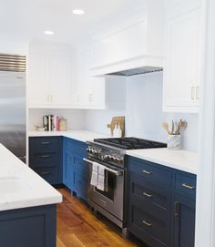 """""""Checked in at one of our projects this afternoon - fresh Benjamin Moore """"Simply White"""" paint, Calacatta counters and brass lights...this kitchen facelift…"""""""
