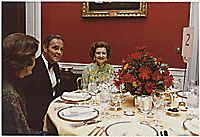 Photograph of First Lady Betty Ford Dining with Alexander Haig and an Unidentified Woman in the Red Room of the White House During a Dinner Held in General Haig's Honor,
