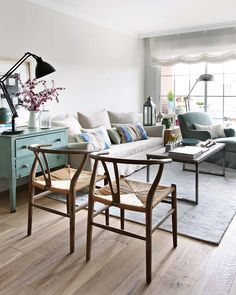 Nice use of small space, light blue chest next to couch is great, as are the chairs, and the green chaise..just young and fresh and not'over-designed