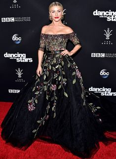 Julianne Hough is wearing a black Georges Hobeika gown with floral embroidery and off shoulder detail. Beautiful gown! I love the off shoulder look.