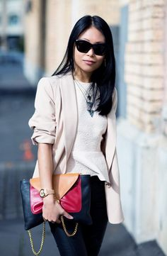 white textured peplum top, cream blazer, black pants, necklaces & bag