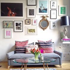 """This gallery wall from P.S. I Made This is on the level and off the hook!  Lovely inclusion of @20x200 artist Matt Jones' """"Get Excited and Make Things"""" print!"""