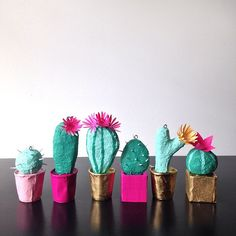 Tiny paper mâché cacti now headed to the @stationeryshow in NYC to decorate @helloluckycards booth! Come say hello!  #1759 #nss2015