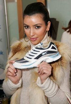 Pose for a photo while holding a single sneaker. | 21 Things Kim Kardashian Did In 2008 That She'd Never Do Now