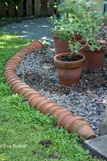 Edge path with terracotta pots laid on their side