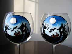 This is for 2 hand painted haunted house themed globe wine glasses each 18 OZ, they were hand painted by me. Get ready for your next Halloween