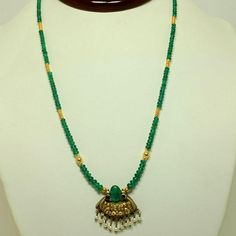 An 18 inch emerald and 18K /22K gold necklace with a Basara pearl and emerald pendant, featuring Basara pearl dangles.  This custom designed necklace and pendant by Tsajon, has 27ct of emeralds.      More about Basara pearls:  The most important sources of natural pearls, which until 1908 were the only kind in use, were the oyster shoals on sandbanks off the island of Bahrein in the Persian Gulf where the best-quality large pearls were found, called Basara pearls, and the waters of the ...