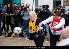 Ealing, London, UK. 9th December, 2014. Mayor of London #BorisJohnson and Stephen Greenhlagh grapple for the ball during a game of netball. © Paul Davey/Alamy Live News