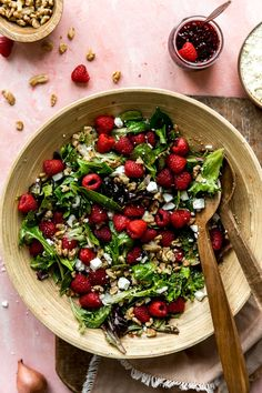 Raspberry Walnut Salad is a vibrant salad loaded with flavor! A homemade raspberry vinaigrette is tossed together with fresh greens, juicy raspberries, crunchy walnuts and creamy feta cheese. Perfect salad to serve along with any meal, serve for a crowd, or to have a delicious salad for lunch. The possibilities are endless with this salad that tastes like Spring! Walnut Salad, Spring Salad, Kinds Of Salad, Easy Healthy Recipes, Food For Thought, Food Print, Feta, Raspberry, Clean Eating