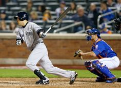 Masahiro Tanaka #19 of the New York Yankees hits a single in the ninth inning as Anthony Recker #20 of the New York Mets defends during inte...