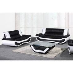 Create a sophisticated atmosphere in your living area with the Christina loveseat and sofa set. Each piece in this set highlights a rich leather upholstery in a two-tone black and white color palette.