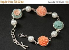 HOLIDAY SALE Peach and Blue Flower Bracelet with Personalized Charm. Blue and Peach Flower Bracelet. Silver Flower and Pearl Bracelet. Handm by StumblingOnSainthood from Stumbling On Sainthood. Find it now at http://ift.tt/2z6hqAo!