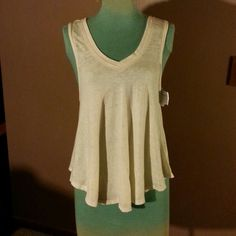 "Free People Tank Top Light Green cotton scoop neck line tank top with semi flared bottom is 25""long never been worn Free People Tops"
