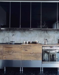 Mixed materials - Modern and rustic.  I don't like the upper cabinets, but those could be open shelving...