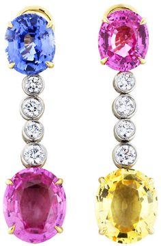 Bulgari 14.00ctw Sapphire Earrings. Estate platinum and 18 karat yellow gold 2 tone drop earrings consisting of 2 oval shaped pink sapphires, 1 yellow sapphire and 1 blue sapphire having a total weight of approximately 14 carats set with 8 bezel set full cut diamonds having a total weight of approximately .60 carats, signed Bvlgari. Via 1stdibs.