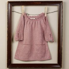 Love this framing idea for my son's baby clothing