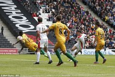 MK Dons' Darren Potter scores the third goal during the 5-1 rout of Yeovil to secure automatic promotion