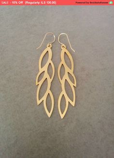 Gold Leaves Earrings, dangle and drop earrings. Matte finished leave design. Made of 14 carat gold plated brass base.  Dimensions: Length: 9/16