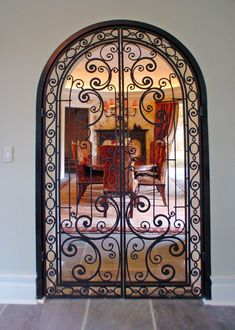 iron scroll door, lovely and good for baby proofing a room from the toddler.