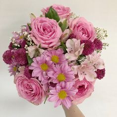 Intriguing hues of pink and purple blooms form an ambience of relaxation and peace. With beautiful Roses, striking Chrysanthemums, exquisite Alstroemeria and delicate Gypsophila this bouquet is a wonderful respite from the trials of everyday life.