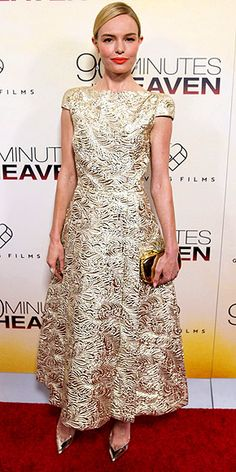 KATE BOSWORTH in a tea length, gold brocade Schiaparelli gown with coordinating gold Nicholas Kirkwood pumps and a clutch at the premiere of her movie, 90 Minutes in Heaven in Atlanta, Ga.