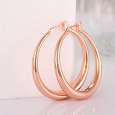 2016 Fashion Women 18k Rose Gold Plate Smooth Hoop Earrin... https://www.amazon.com/dp/B00VBA6ZAC/ref=cm_sw_r_pi_dp_x_1eBhybTD9YMG4