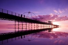 Photo of the day: Reflected Pier by Ken Wilson. A stunning landscape shot with fantastic symmetry and lead-in lines