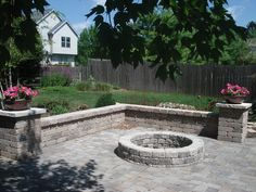 Stone wall and firepit on paver patio. Can something like this be done with concrete?