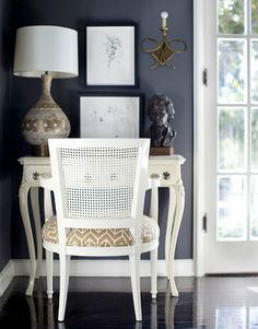 nice balance of color (light & dark)  nice wall & table composition  nice continuity of 3rd color between lamp and chair  I'll take this corner!