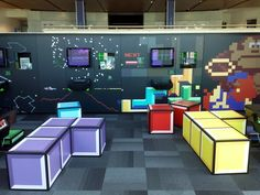 Games Lounge - National Media Museum in Bradford. Tetris style seating, retro Gaming Wall, Donkey Kong Mural