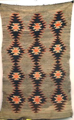TRANSITIONAL NAVAJO RUG. A carded gray background
