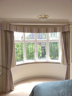 Arched Window Dressed With Voile Curtain Inside Recess
