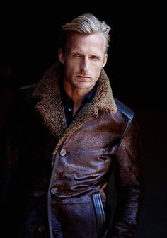 Mens Fashion. Dark Brown Shearling Fitted Cropped Jacket, dark JeNs, and Blonde Hair. He's Ready for a Norwegian Winter.