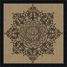 Framed medallion motif on burlap. Made in the USA. Product: Wall artConstruction Material: Black frameFeatures: Intricate and ornate designDimensions: H x W