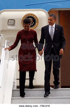 Is MBam starting a new trend? The First Lady of Fashion is spotted exiting Air Force One in Indonesia in a printed red dress and black pants on Nov. Black Presidents, Greatest Presidents, American Presidents, Barrack And Michelle, Michelle And Barack Obama, Mr Obama, Barack Obama Family, First Black President, Our President