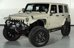 2014 Jeep Wrangler Unlimited in Bentley White Sand Kevlar Exterior: Front-Left View