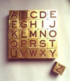 gold metallic wood letter blocks