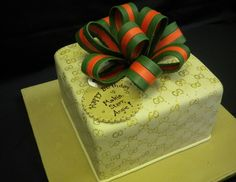 gucci+cakes | Gucci birthday cake with green and red sugar bow and gift tag.