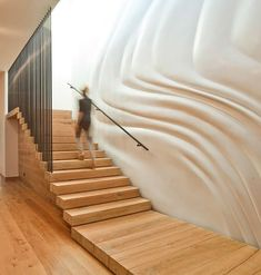 Now here is a unique decorating idea for stairway walls. The sole purpose of a stairway is to get you from one floor to the other. People don't gather...