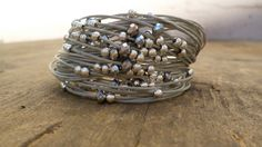 string beaded bracelet textile jewelry multistring bracelet handmade in Italy  Easy to wear and perfect under a blouse for a natural/shabby look or whatever you want because is matchable with almost of the colours.  The lenght is about cm 19/7.68 ******* adjustable for wrist from 7 to 7.49   (for other lenght contact me and I will make the size desired)   ***************************************Ready to ship*****************************   I design and handcraft each piece of my jewel...