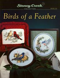 Cover photo of Stoney Creek Book 116 Birds of a Feather showing cross stitch designs of realistic birds