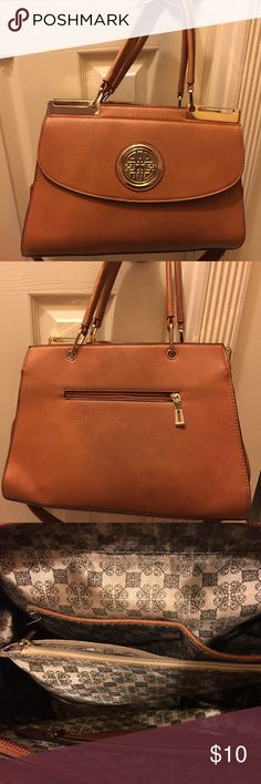 """Tan Huge Purse Big tan """"Mary Poppins"""" purse with gold toned details. Lined as seen in the 3rd pic. It's been used. Minor scuff marks as noted in the 4th pic. (15x10x5) Don't need it since it's too big. Given as a gift. Smoke free home. Bags"""