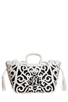 White laser-cut leather from the Ralph Lauren Spring RTW Accessories  Collection. 76b437a79d852