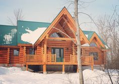 Milled log home constructed by Kealey & Tackaberry Log Homes of Pakenham Ontario.