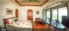 The upstairs bedroom with a walk-in closet at Casa De Los Suenos. Located in Hermosa Heights, Guanacaste Costa Rica.