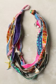 Anthropology : We Love Vera scarf-scrap necklace. . .     Replicate with scraps of silk or other fabric, by simply tying approx. 1 in scraps together, finish the edges with zig-zag stitch on machine or surger if you want. Leave a loop of scrap on one end when you tie them together and knot the other end to create a clasp. This could be made for $0.00 Can't believe they were charging $-148